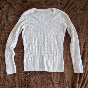 V-neck cable knit sweater.
